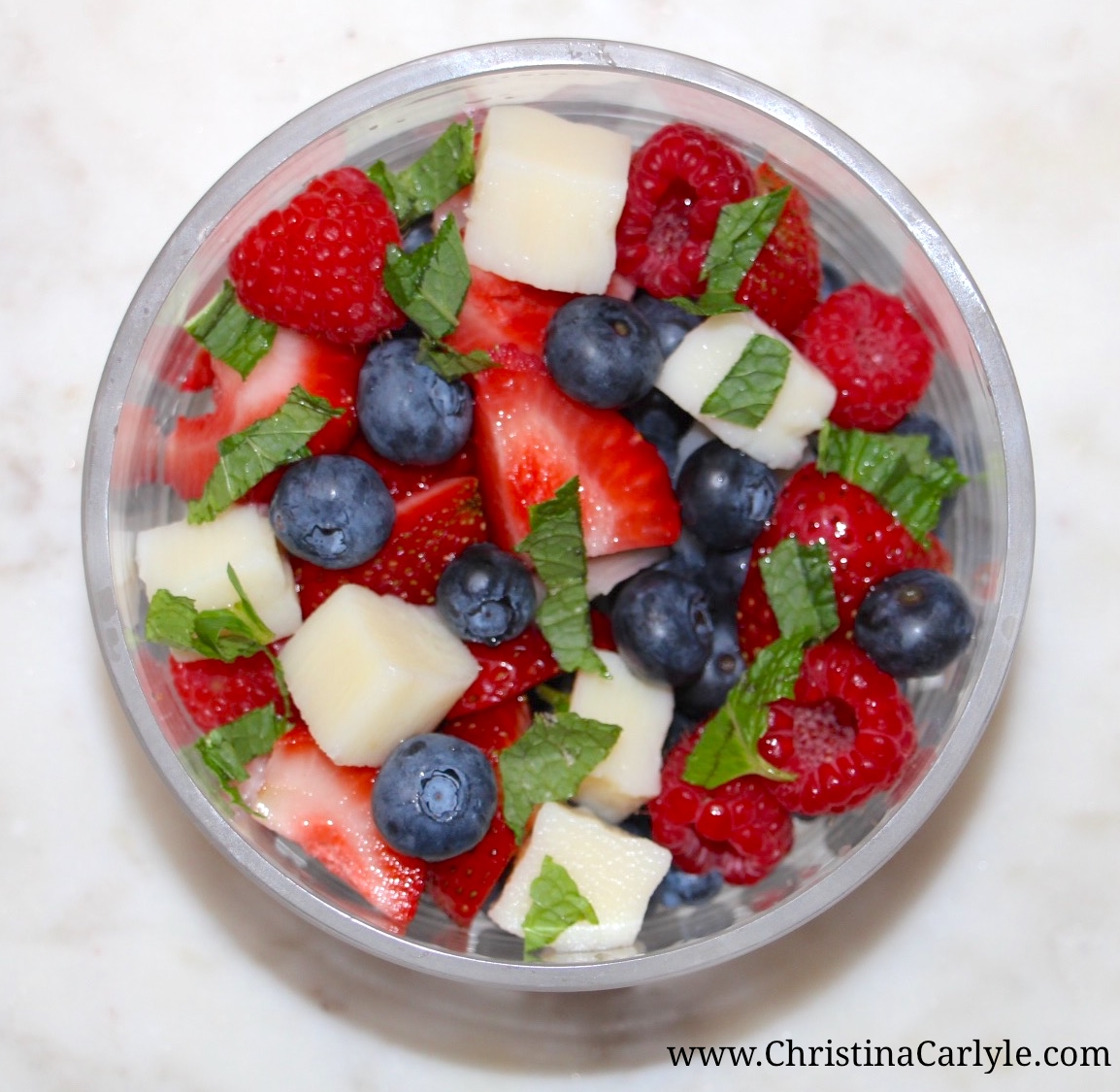 Healthy 4th of July Recipes - Red, White and Blue Berries and Hearts of Palm Salad from nutritionist Christina Carlyle. Nutritious, Delicious, and Easy Healthy 4th of July Recipes you can enjoy guilt-free.  These delicious, Healthy 4th of July Recipes are high in nutrients and fiber but low in calories, fat, and sugar.  https://www.christinacarlyle.com/healthy-4th-of-july-recipes