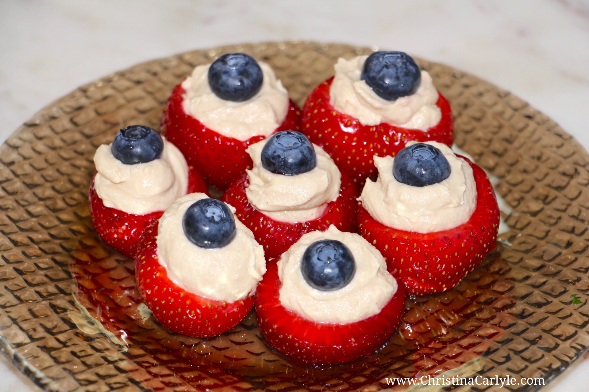 Red white and Blue Hummus Blueberry and Strawberry Bites Recipe | Healthy 4th of July Recipes from nutritionist Christina Carlyle https://www.christinacarlyle.com/healthy-4th-of-july-recipes/