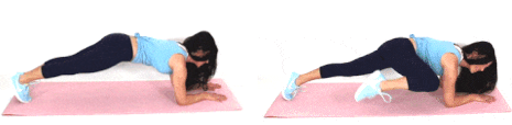 Christina Carlyle doing a tuck crunch plank ab exercise
