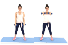 Christina Carlyle doing the Front Extensions Arm Exercise at Home